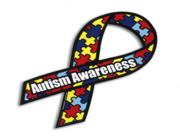 A folded ribbon with the autism puzzle pieces on it.