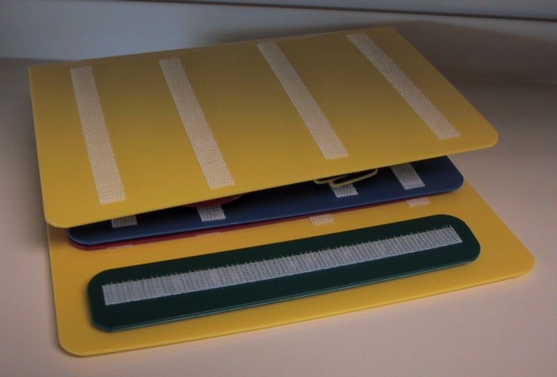 picture of a small three-ring PECS book with velcro strips on pages